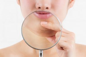 Double chin under magnifying glass