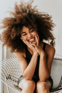 Woman smiling after gynecologist appointment.